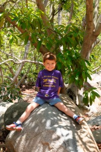 Our oldest son, Evan, climbing boulders at the Farm.
